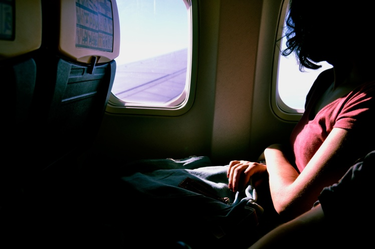 passenger on plane looking out window