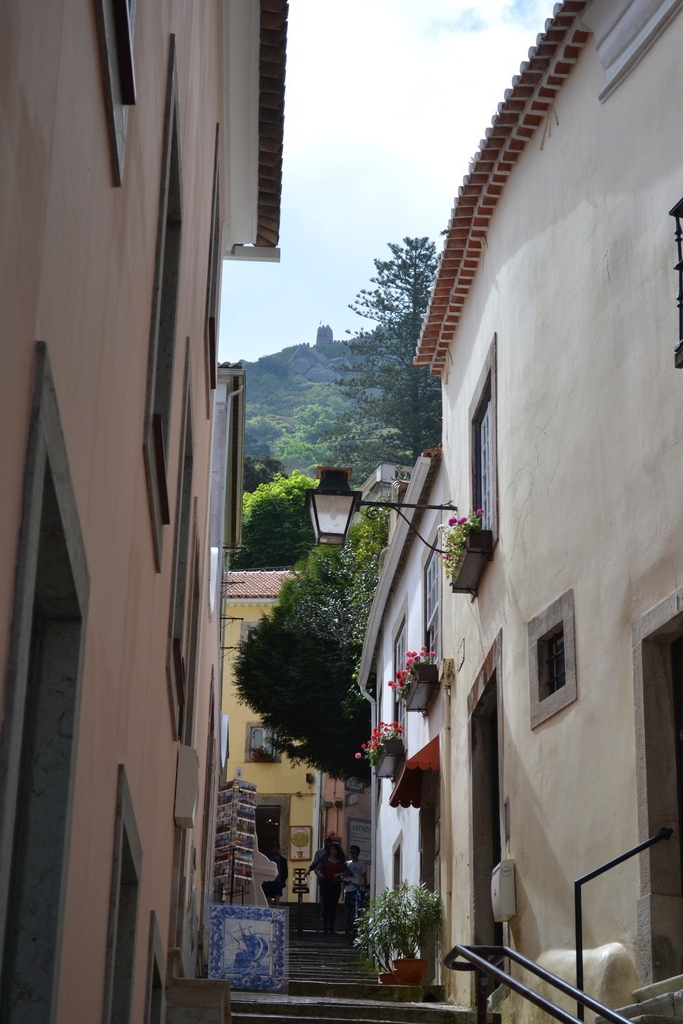 A street in Sintra with the Castelo dos mouros in the background