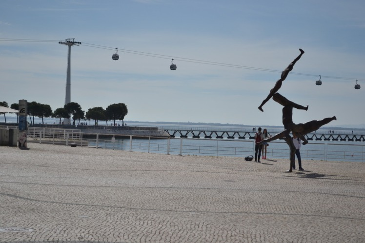 cable car and statue at Parque das Naçoes Lisboa