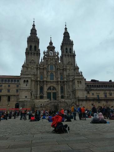 Santiago de Compostela Cathedral with pilgrims in Plaza do Obradoiro